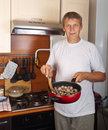 man-cooks-meat for family